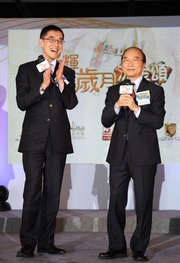 The Club's Executive Director, Charities, Legal & Corporate Secretariat, Douglas So (left), and Director of Broadcasting Franklin Wong (right) review previous 18-District Programme events with the audience.